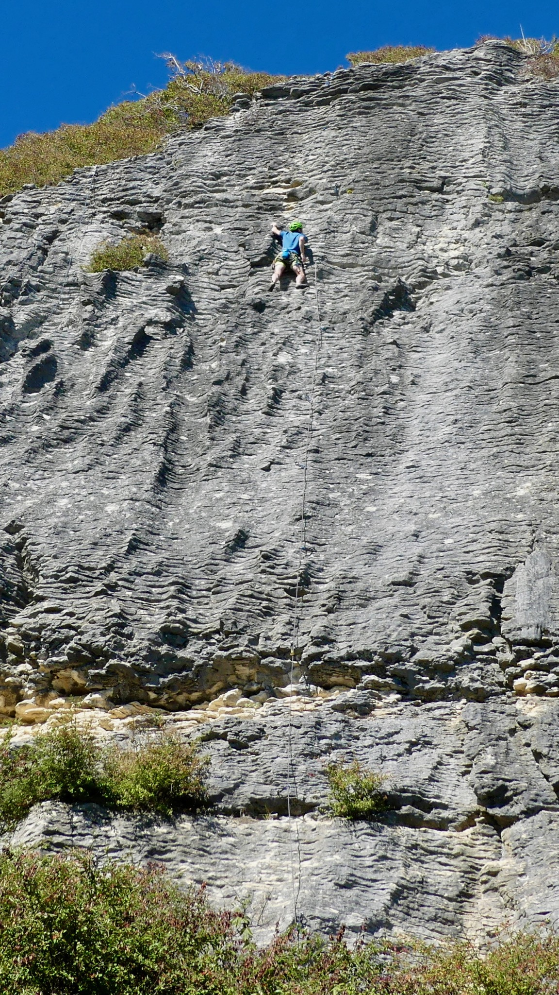Alexei lead-climbing Marisol (grade 17) route on the Cathedral wall at Pohara.