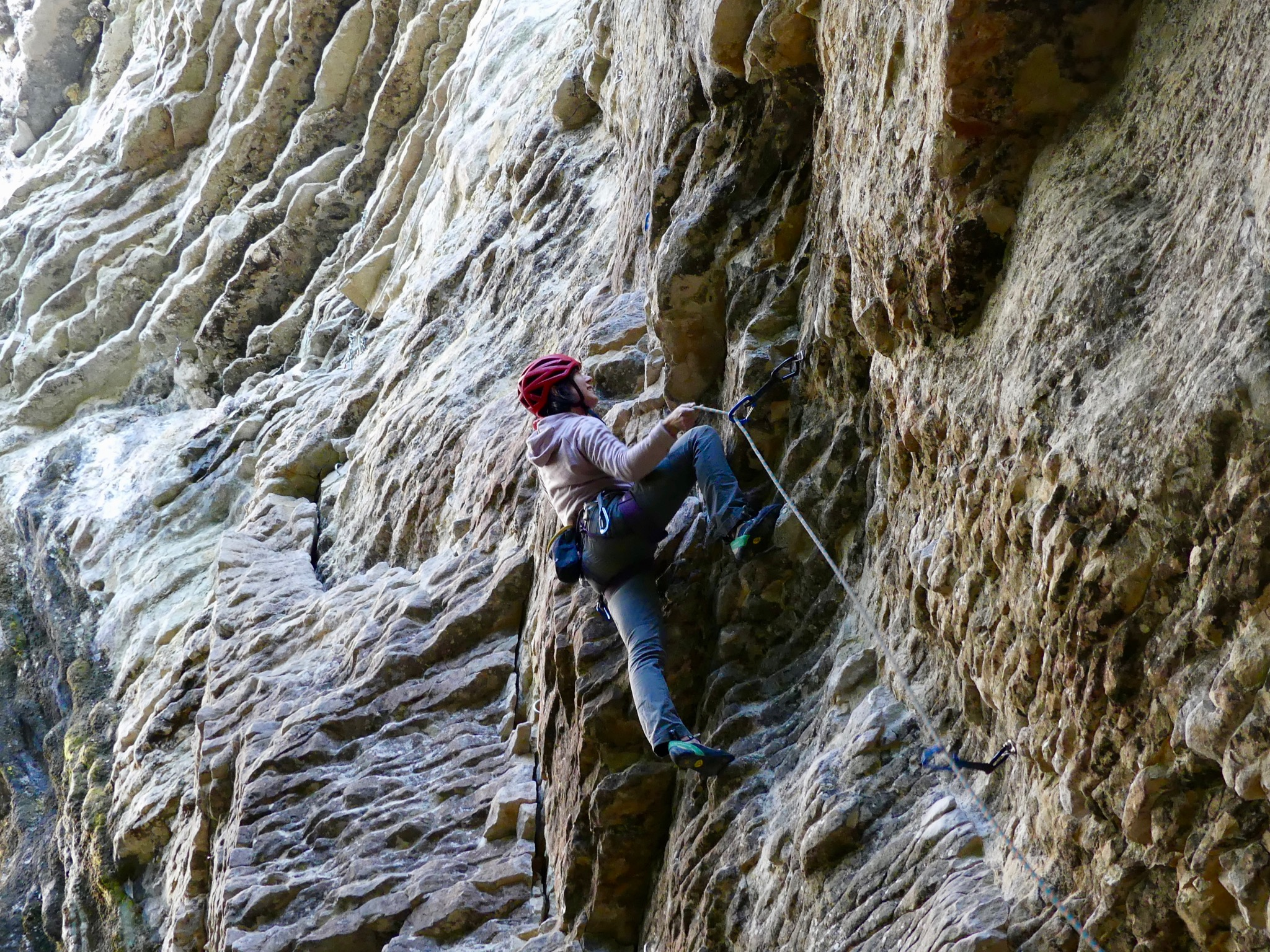 Alex about to clip the fourth bolt on Trojan Kat (grade 20) in the Colosseum at Mangaokewa